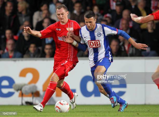 Patrick Kohlmann of Union battles for the ball with Nikita Rukavytsya of Hertha during the Second Bundesliga match between 1FC Union Berlin and...