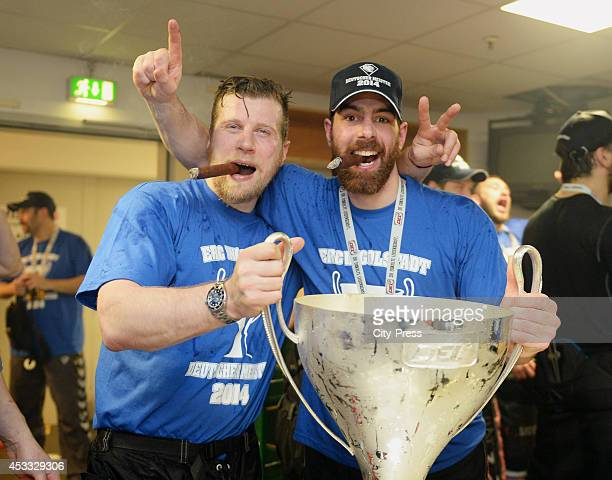 Patrick Köppchen and Derek Dinger celebrate the championship with the trophy after game seven of the DEL playoff final on April 29, 2014 in Cologne,...
