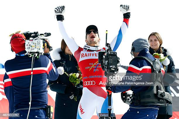 Patrick Kueng of Switzerland celebrates in front of the cameras after winning the gold medal during the FIS Alpine World Ski Championships Men's...