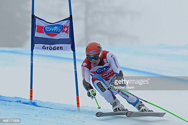 Patrick Kueng of Switzerland competes during the Audi FIS Alpine Ski World Cup Super G race on December 20 2013 in Val Gardena Italy