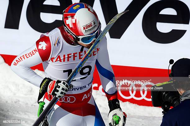 Patrick Kueng of Switzerland kisses his skis after winning the gold medal during the FIS Alpine World Ski Championships Men's Downhill on February 07...