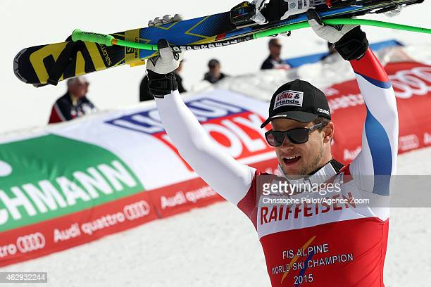 Patrick Kueng of Switzerland raises his skis in celebration after winning the gold medal during the FIS Alpine World Ski Championships Men's Downhill...