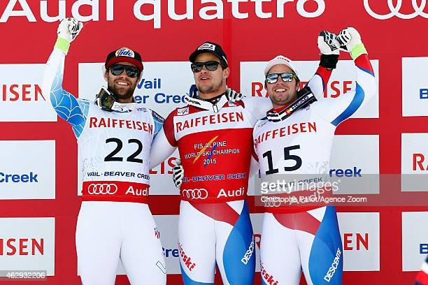 Patrick Kueng of Switzerland wins the gold medal Travis Ganong of the USA wins the silver medal Beat Feuz of Switzerland wins the bronze medal during...