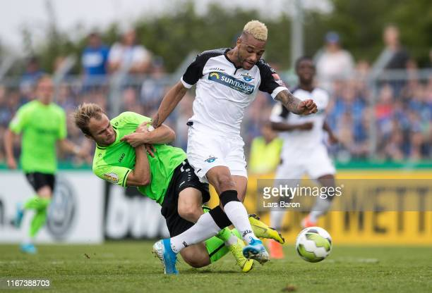 Patrick Kurzen of Roedinghausen challenges Khiry Shelton of Paderborn during the DFB Cup first round match between SV Roedinghausen and SC Paderborn...