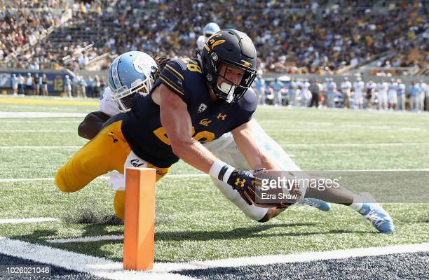 Patrick Laird of the California Golden Bears dives past Jonathan Smith of the North Carolina Tar Heels for a touchdown at California Memorial Stadium...