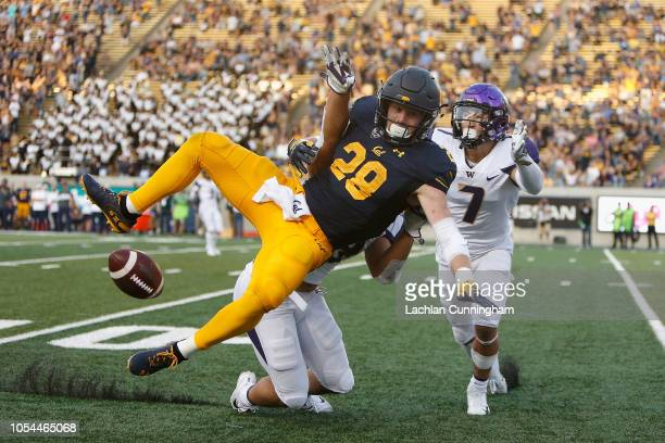Patrick Laird of the California Golden Bears is defended by Brandon Wellington and Taylor Rapp of the Washington Huskies at California Memorial...
