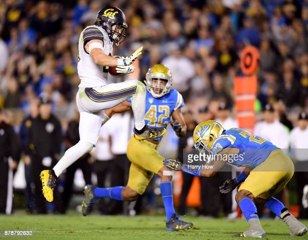Patrick Laird of the California Golden Bears jumps over Will Lockett of the UCLA Bruins during the third quarter at Rose Bowl on November 24 2017 in...