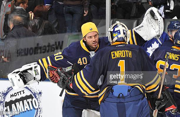 Patrick Lalime and Jhonas Enroth of the Buffalo Sabres celebrate a win over the Toronto Maple Leafs November 6, 2010 at the Air Canada Centre in...