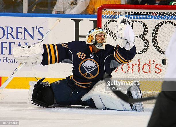 Patrick Lalime of the Buffalo Sabres can't stop a redirected shot by Teddy Purcell of the Tampa Bay Lightning at HSBC Arena on November 20, 2010 in...