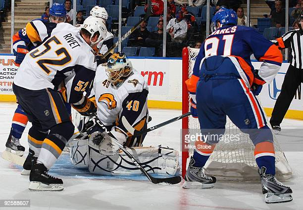 Patrick Lalime of the Buffalo Sabres makes the save against the New York Islanders on October 31, 2009 at Nassau Coliseum in Uniondale, New York.