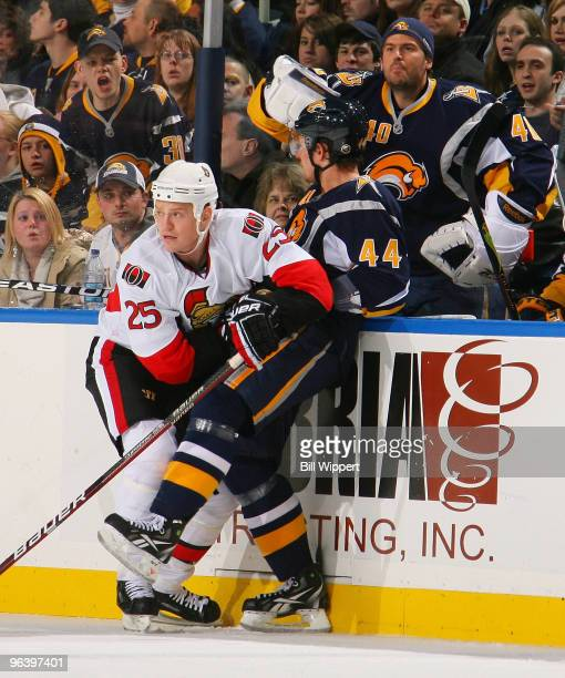Patrick Lalime of the Buffalo Sabres protests the check of Chris Neil of the Ottawa Senators on Andrej Sekera of the Sabres on February 3, 2010 at...