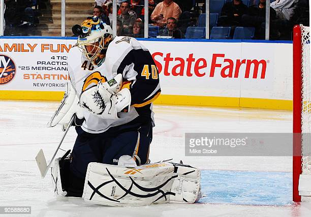 Patrick Lalime of the Buffalo Sabres saves the puck with his mask against the New York Islanders on October 31, 2009 at Nassau Coliseum in Uniondale,...