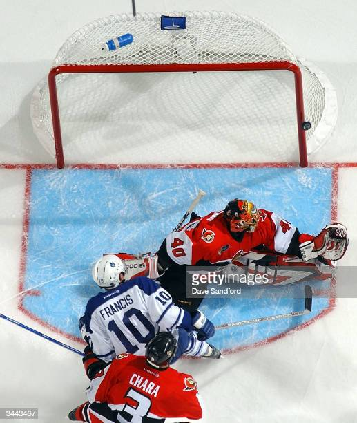 Patrick Lalime of the Ottawa Senators gets beat on this shot by Ron Francis of the Toronto Maple Leafs as Zdeno Chara of the Senators tries to...