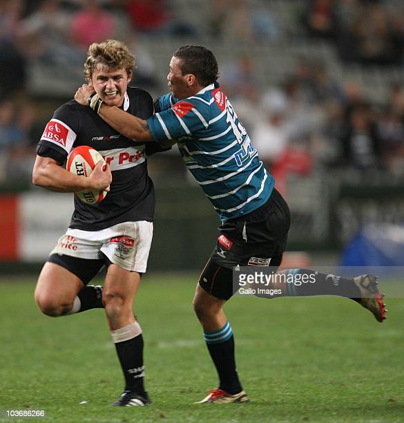 Patrick Lambie of the Sharks looks to get away from Wilmaure Louw during the Absa Currie Cup match between the Sharks and GWK Griquas at Absa Stadium...
