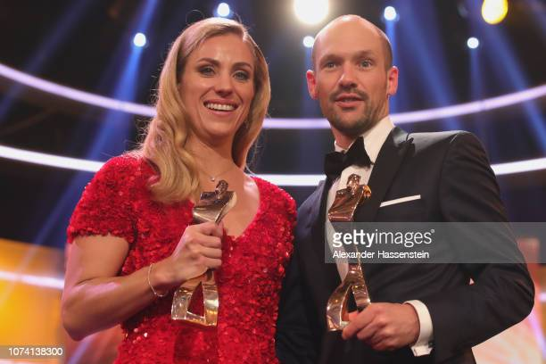 Patrick Lange and Angelique Kerber pose with their sportsman of the year award after the 'Sportler des Jahres 2018' Gala at Kurhaus Baden-Baden on...