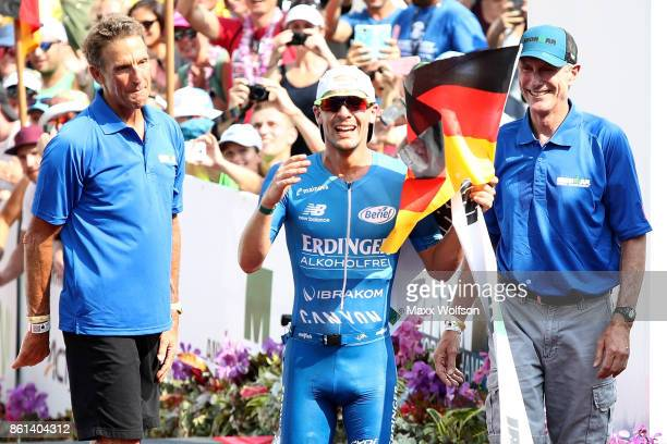 Patrick Lange of Germany celebrates afer winning the IRONMAN World Championship and setting a course record of 80139 beating Craig Alexander's 2011...