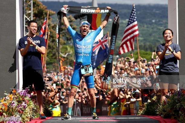 Patrick Lange of Germany celebrates after setting a course record of 75239 to win the IRONMAN World Championships brought to you by Amazon on October...