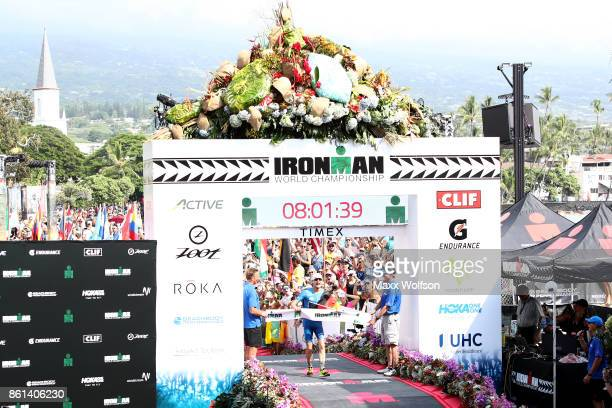 Patrick Lange of Germany celebrates after winning the IRONMAN World Championship and setting a course record of 80139 beating Craig Alexander's 2011...