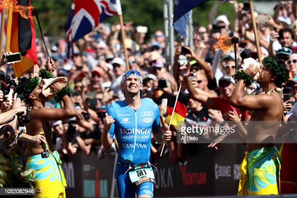 Patrick Lange of Germany celebrates before he crosses the finish line and sets a course record of 75239 to win the IRONMAN World Championships...