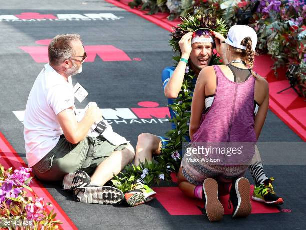 Patrick Lange of Germany celebrates with his family after winning the IRONMAN World Championship and setting a course record of 80139 beating Craig...