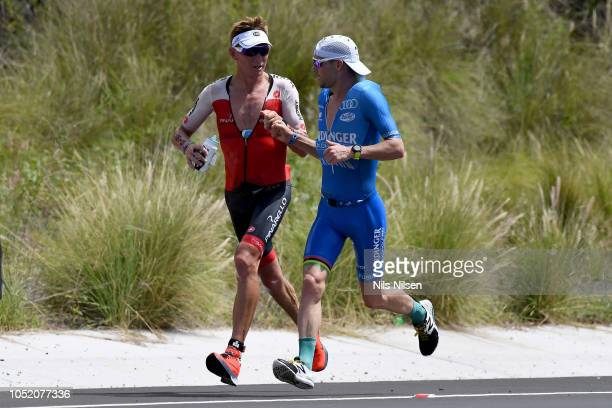 Patrick Lange of Germany passes Cameron Wurf of Australia on the run during the IRONMAN World Championships brought to you by Amazon on October 13...