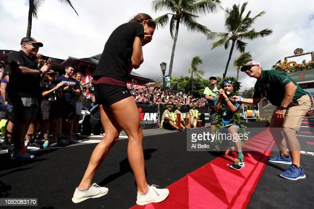 Patrick Lange of Germany proposes to his girlfriend Julia Hofmann after Lange sets a course record of 75239 to win the IRONMAN World Championship...