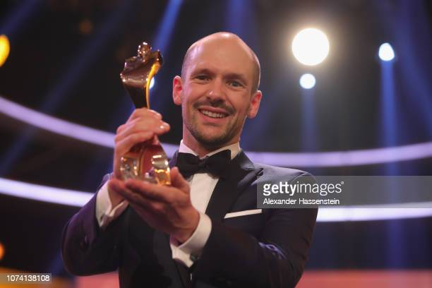 Patrick Lange poses with the sportsman of the year award after the 'Sportler des Jahres 2018' Gala at Kurhaus Baden-Baden on December 16, 2018 in...