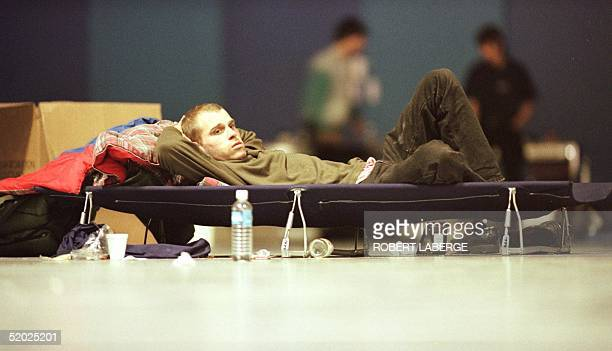 Patrick Laviolette a homeless man lies on a makeshift bed 10 January in a Montreal shelter where he found refuge following the fiveday ice storm that...