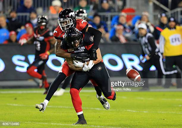 Patrick Lavoie of the Ottawa Redblacks fumbles the ball after a tackle by Tommie Campbell of the Calgary Stampeders during the 104th Grey Cup...