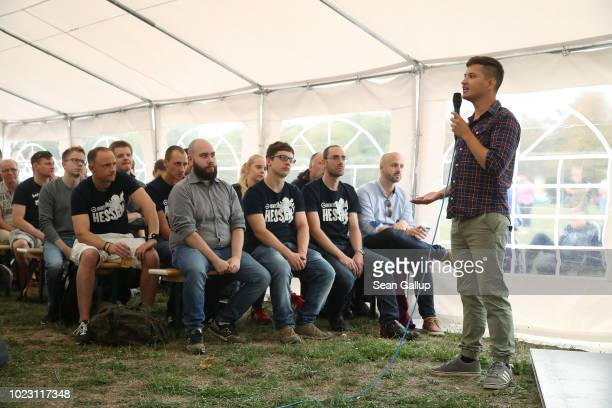 Patrick Lenart an Austrian member of the Identitarian Movement speaks to visitors at a gathering entitled Europa Nostra and hosted by the...
