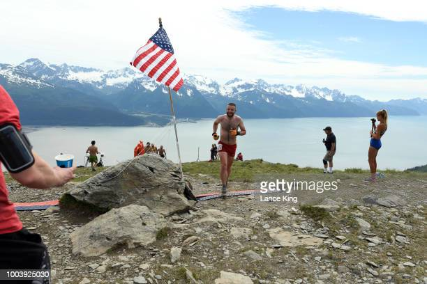 Patrick Lewis smiles as he reaches the top of Mount Marathon during the Men's Division of the 91st Running of the Mount Marathon Race on July 4 2018...