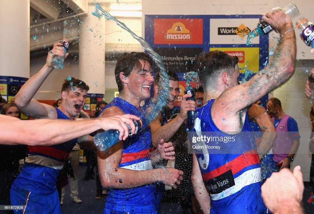 Patrick Lipinski and Hayden Crozier of the Bulldogs are sprayed with drinks as the Bulldogs celebrate winning the AFL round six match between the Western Bulldogs and Carlton Blues at Etihad Stadium on April 27, 2018 in Melbourne, Australia.