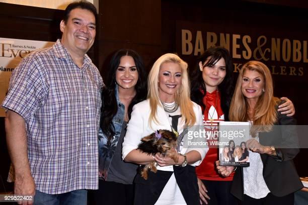 Patrick Lovato Demi Lovato Dallas Lovato Madison De La Garza and author Dianna De La Garza pose together at the signing of Dianna De La Garza's new...