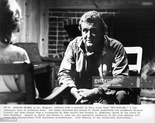 Patrick Macnee as Dr. Wagner, confers with a patient in a scene from the film 'The Howling', 1981.