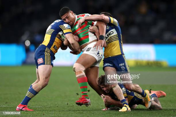 Patrick Mago of the Rabbitohs is tackled during the round 16 NRL match between the Parramatta Eels and the South Sydney Rabbitohs at Bankwest Stadium...