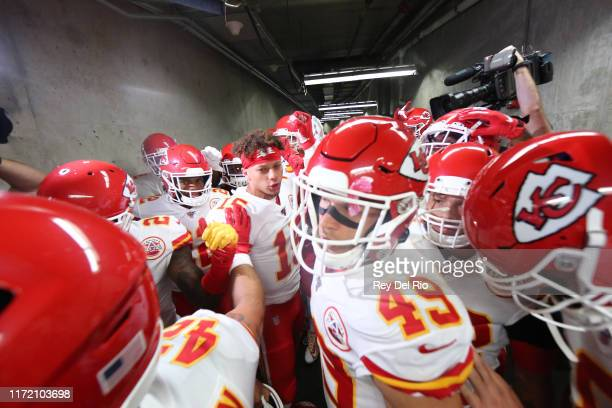 Patrick Mahomes Anthony Sherman and Daniel Sorensen of the Kansas City Chiefs make their way to the field prior to the start of the game aganist the...
