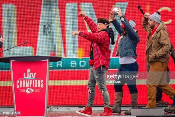 Patrick Mahomes Anthony Sherman of the Kansas City Chiefs and other chiefs members celebrate on stage during the Kansas City Chiefs Victory Parade on...