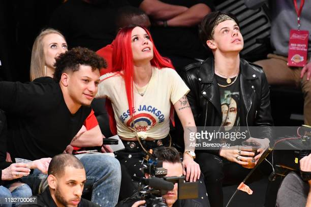 Patrick Mahomes Brittany Matthews Halsey and musician Yungblud attend a basketball game between the Los Angeles Lakers and the New Orleans Pelicans...