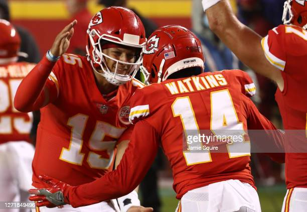 Patrick Mahomes celebrates a touchdown with teammate Sammy Watkins of the Kansas City Chiefs during the second quarter against the Houston Texans at...