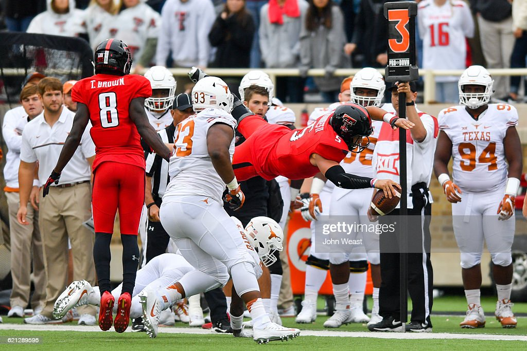 Patrick Mahomes II #5 of the Texas Tech Red Raiders dives for the first down marker during the game against the Texas Tech Red Raiders on November 5, 2016 at AT&T Jones Stadium in Lubbock, Texas. Texas defeated Texas Tech 45-37.