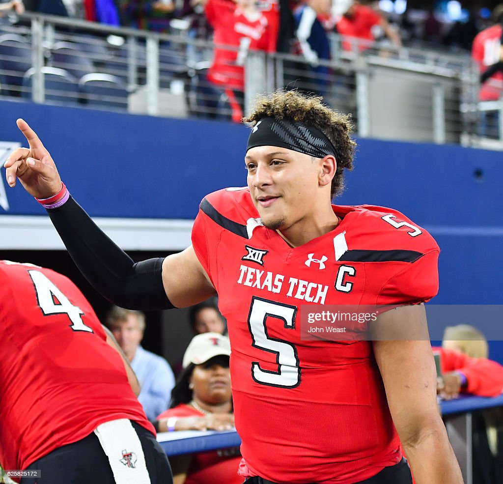 Patrick Mahomes II #5 of the Texas Tech Red Raiders interacts with fans after the game against the Baylor Bears on November 25, 2016 at AT&T Stadium in Arlington, Texas. Texas Tech defeated Baylor 54-35.
