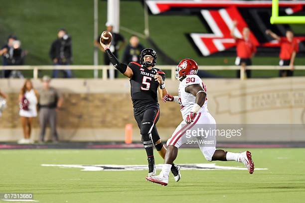 Patrick Mahomes II of the Texas Tech Red Raiders passes the ball under pressure from Neville Gallimore of the Oklahoma Sooners during the game on...