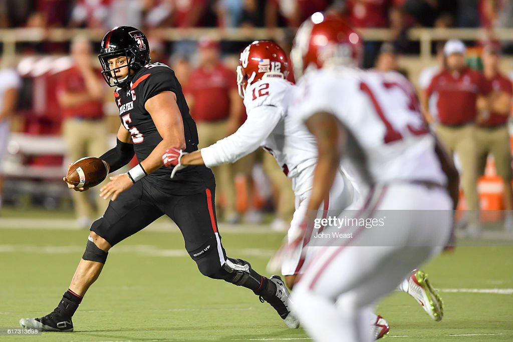 Patrick Mahomes II #5 of the Texas Tech Red Raiders scrambles with the ball during the game against the Oklahoma Sooners on October 22, 2016 at AT&T Jones Stadium in Lubbock, Texas. Oklahoma won the game 66-59.