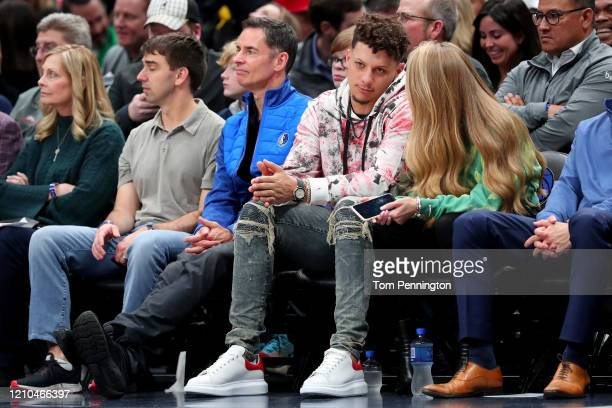 Patrick Mahomes of the Kansas City Chiefs and girlfriend Brittany Matthews look on as the Dallas Mavericks take on the New Orleans Pelicans at...