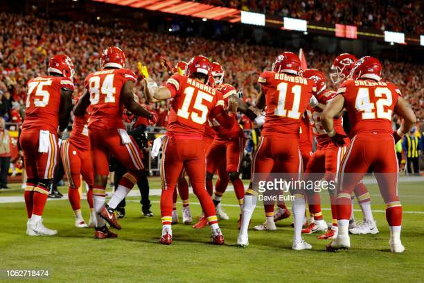 Patrick Mahomes of the Kansas City Chiefs and the entire offense celebrate the games first touchdown with a dance party in the end zone during the...