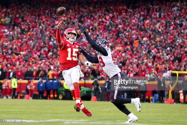 Patrick Mahomes of the Kansas City Chiefs attempts a pass under pressure from J.J. Watt of the Houston Texans during the third quarter in the AFC...