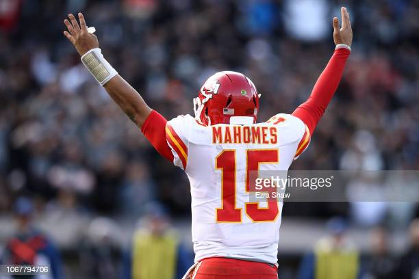 Patrick Mahomes of the Kansas City Chiefs celebrates after a touchdown by Spencer Ware against the Oakland Raiders during their NFL game at...