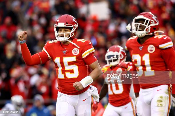 Patrick Mahomes of the Kansas City Chiefs celebrates after Damien Williams scored a 3 yard touchdown against the Oakland Raiders during the first...