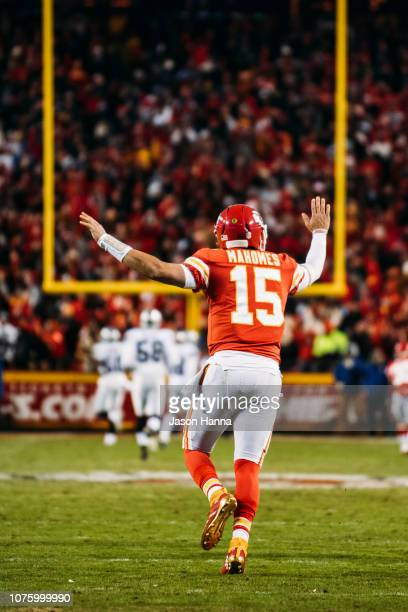 Patrick Mahomes of the Kansas City Chiefs celebrates after throwing his fiftieth touchdown of the season during the third quarter of the game against...