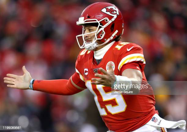 Patrick Mahomes of the Kansas City Chiefs celebrates an eight yard touchdown pass against the Houston Texans during the fourth quarter in the AFC...